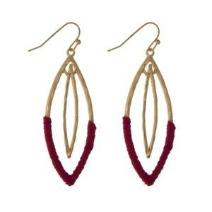 Interlocking oval earrings with magenta threads
